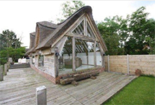 New build - timber framed thatched garden room